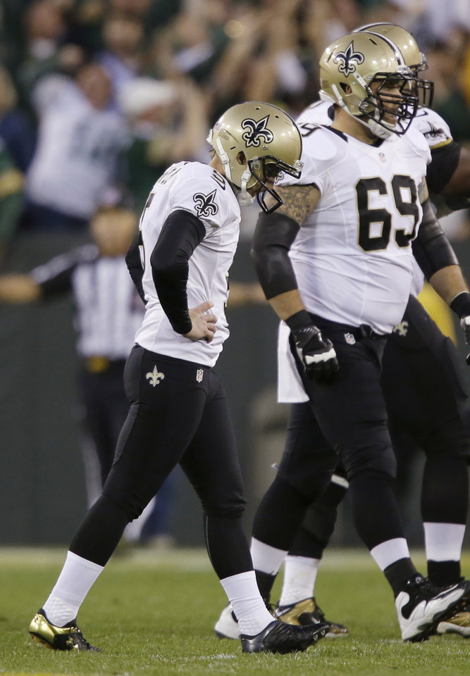 New Orleans Saints' Garrett Hartley walks off after missing a field goal during the fourth quarter against the Green Bay Packers in an NFL football game Sunday, Sept. 30, 2012, in Green Bay, Wis. Green Bay won 28-27. (AP Photo/Jeffrey Phelps)