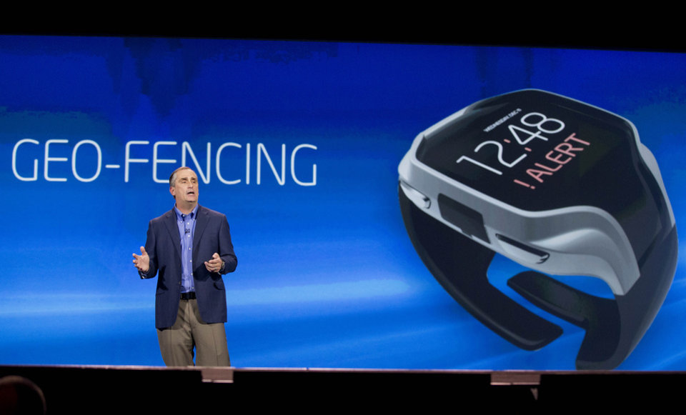 Photo - Intel CEO Brian Krzanich talks about geo-fencing in a wearable tracker during a keynote address at the Consumer Electronics Show, Monday, Jan. 6, 2014, in Las Vegas. (AP Photo/Julie Jacobson)