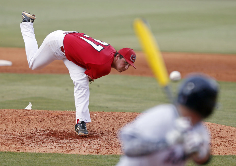 Photo - Jacksonville State pitcher Graham Officer watches his pitch to a Mississippi batter during the third inning of an NCAA college baseball regional tournament game in Oxford, Miss., Saturday, May 31, 2014. (AP Photo/Rogelio V. Solis)