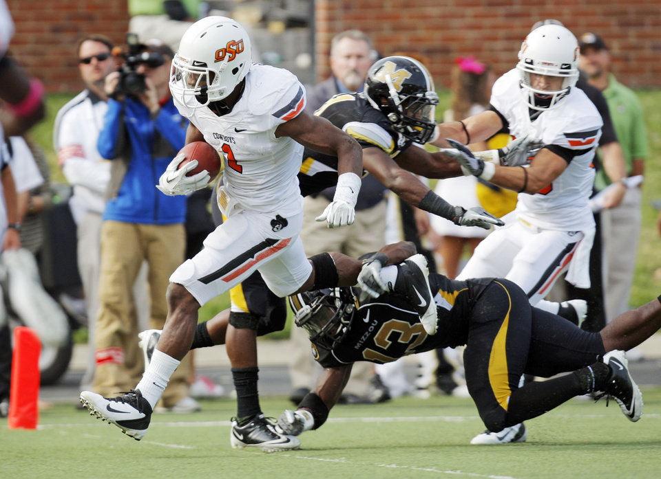 Oklahoma State's Joseph Randle (1) breaks away from, Missouri's Kenji Jackson (13) on a touchdown run in the fourth quarter during a college football game between the Oklahoma State University Cowboys (OSU) and the University of Missouri Tigers (Mizzou) at Faurot Field in Columbia, Mo.,  OSU won, 45-24. Saturday, Oct. 22, 2011. Photo by Nate Billings, The Oklahoman