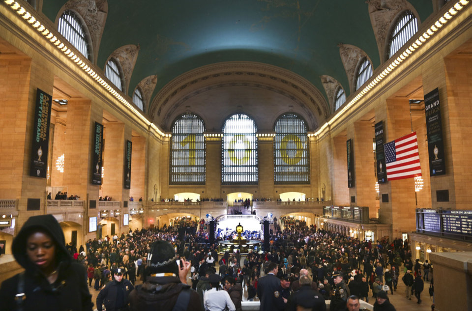 Photo - Crowds gather as Grand Central Terminal kicks off its centennial celebration on Friday, Feb. 1, 2013 in New York. New Yorkers are celebrating the 100th birthday of Grand Central terminal with music, speeches and a cake shaped like the main concourse's famous clock. (AP Photo/Bebeto Matthews)