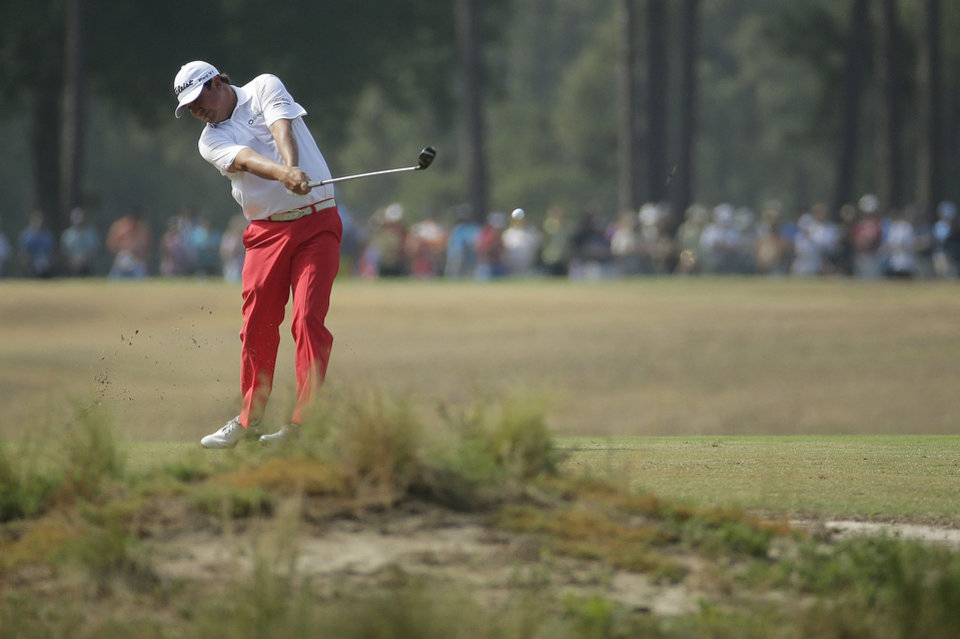 Photo - Jason Dufner hits from the fairway on the 16th hole during the second round of the U.S. Open golf tournament in Pinehurst, N.C., Friday, June 13, 2014. (AP Photo/Charlie Riedel)