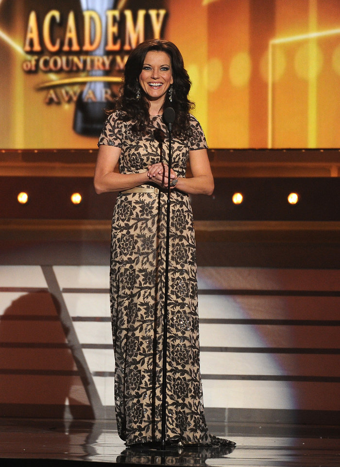 Photo - Martina McBride speaks on stage at the 49th annual Academy of Country Music Awards at the MGM Grand Garden Arena on Sunday, April 6, 2014, in Las Vegas. (Photo by Chris Pizzello/Invision/AP)