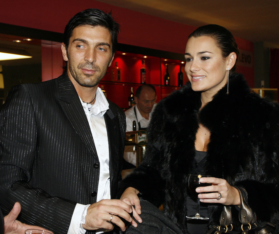 Photo - FILE - In this in this Nov. 25, 2006 file photo Czech top model Alena Seredova, right, and her partner, Juventus Turin goalkeeper Gianluigi Buffon, left, attend the premiere of a musical at Prague's Hybernia Theatre. Italy captain Gianluigi Buffon's announcement that he is separating from his wife caught coach Cesare Prandelli off guard as the Azzurri opened their World Cup training camp Tuesday, May 20, 2014. Prandelli says he was