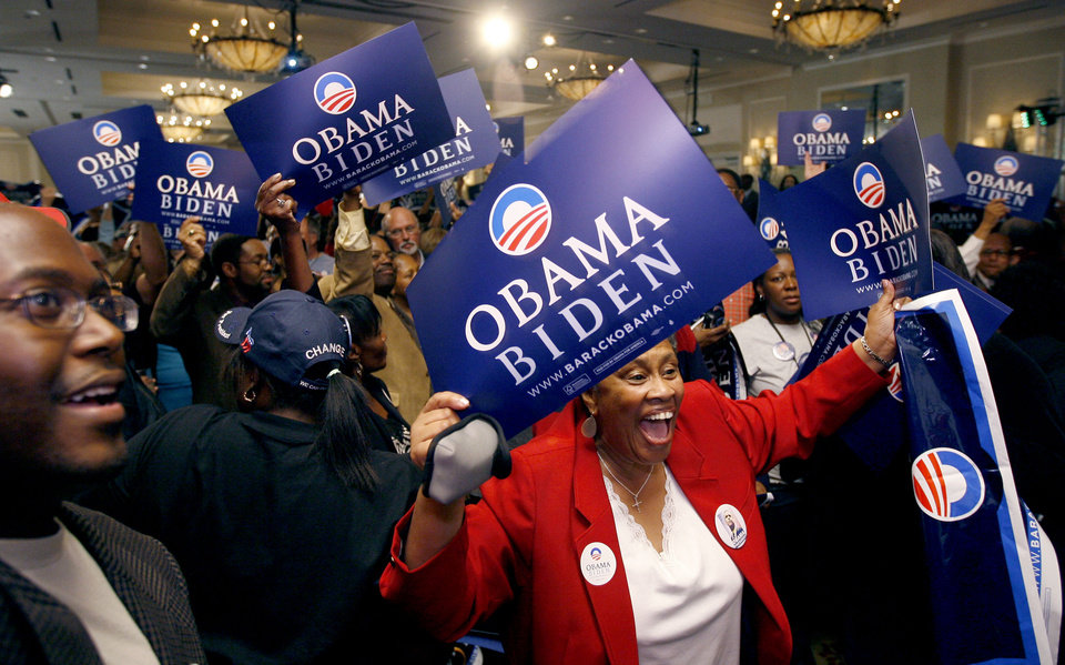Photo - Bettye Moulden of Midwest City celebrates during the Democratic watch party for the presidential election in Oklahoma City, Tuesday, November 4, 2008. BY BRYAN TERRY, THE OKLAHOMAN