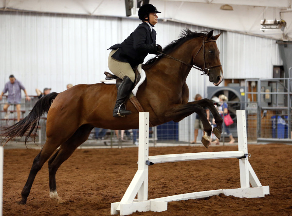 Photo -  Casey Sendek guides Doctor Approved over a hurdle in the Working Hunter Class during the Cleveland County Free Fair Horse Show. PHOTO BY STEVE SISNEY, THE OKLAHOMAN   STEVE SISNEY -