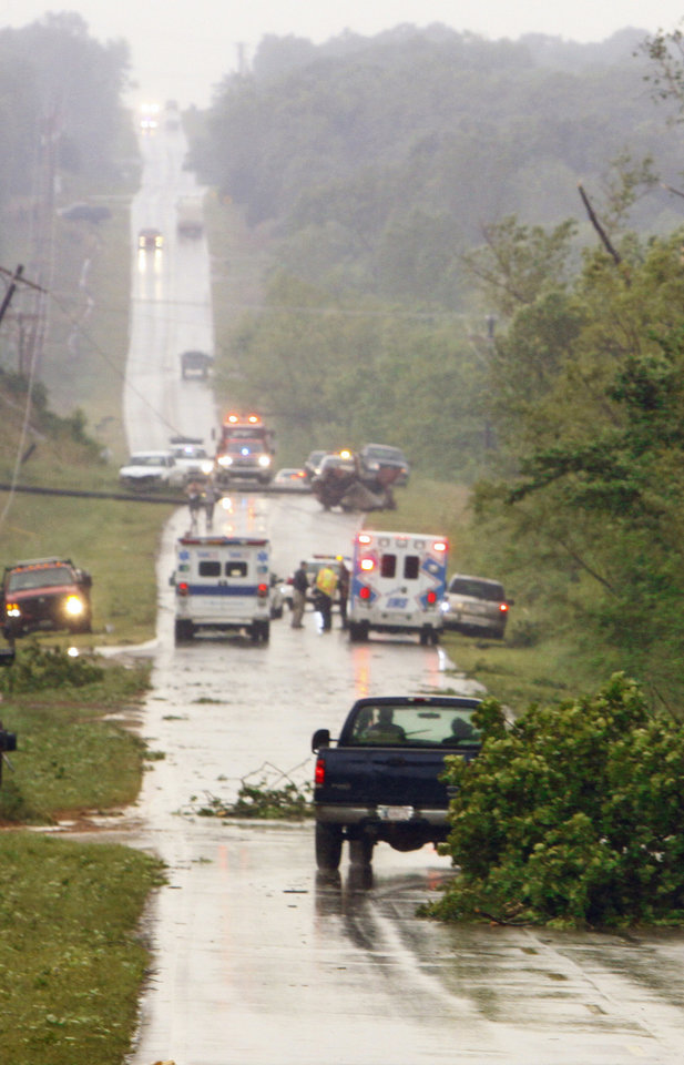 Emergency personnel arrive Monday at 180th Street, north of Highway 9 in Norman near Little Axe, after a storm tore through the area.  Photo by Steve Sisney,  The Oklahoman