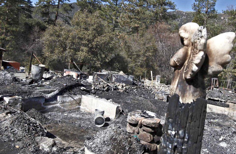 The burned-out cabin where Christopher Dorner's remains were found is seen Friday Feb. 15, 2013 after a police standoff Tuesday near Big Bear, Calif.  The basement area, lower left, is where Dormer's body was found. (AP Photo/Nick Ut)