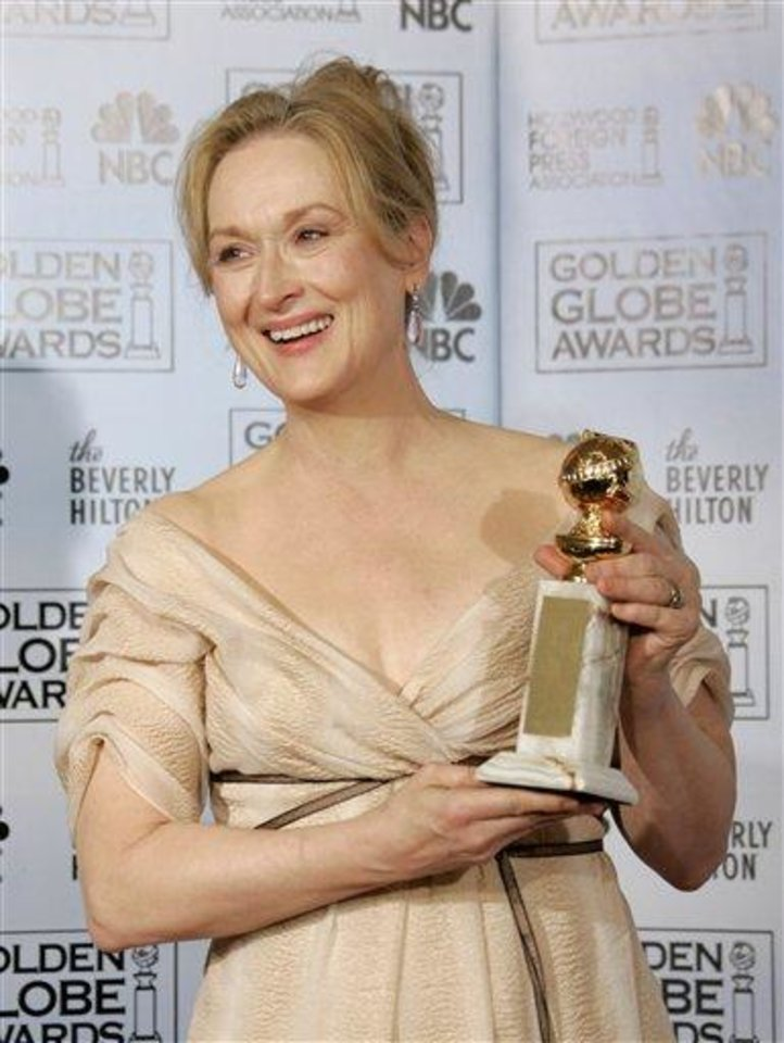 "Meryl Streep poses with the award she won for best actress in a musical or comedy for her work in ""The Devil Wears Prada,"" at the 64th Annual Golden Globe Awards on Monday, Jan. 15, 2007, in Beverly Hills, Calif. (AP Photo/Kevork Djansezian)"