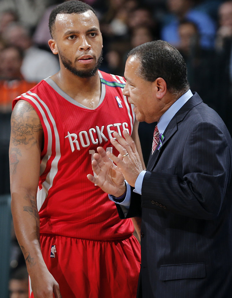 Houston's Kelvin Sampson talks with Daequan Cook (14) during the NBA basketball game between the Houston Rockets and the Oklahoma City Thunder at the Chesapeake Energy Arena on Wednesday, Nov. 28, 2012, in Oklahoma City, Okla.   Photo by Chris Landsberger, The Oklahoman