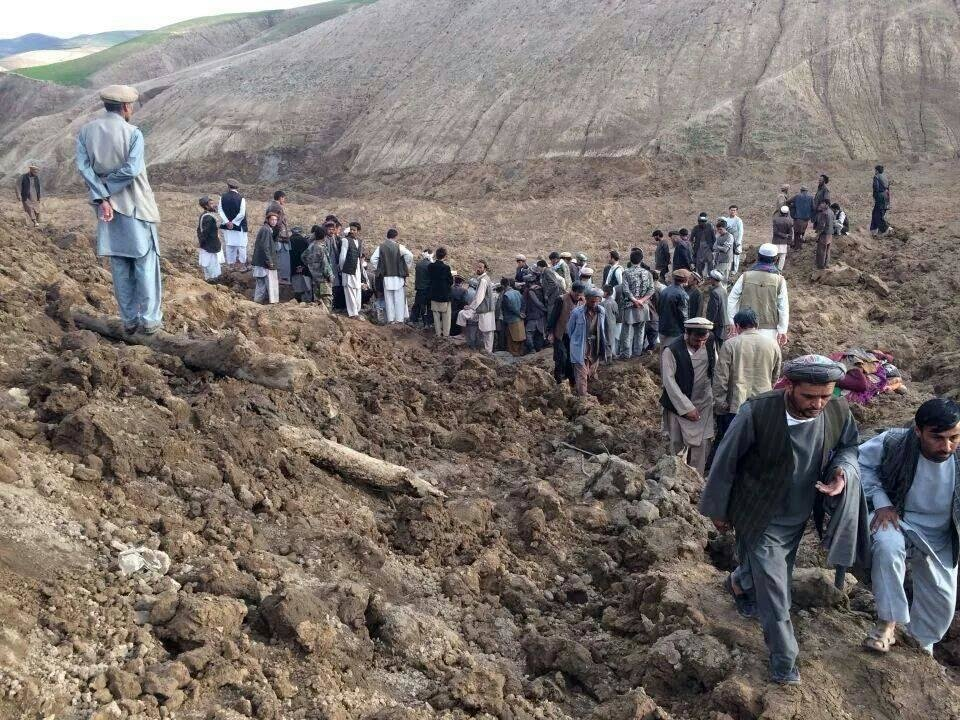 Photo - Afghans search for survivors after a massive landslide landslide buried a village Friday, May 2, 2014 in Badakhshan province, northeastern Afghanistan, which Afghan and U.N. officials say left hundreds of dead and missing missing.(AP Photo/Ahmad Zubair)