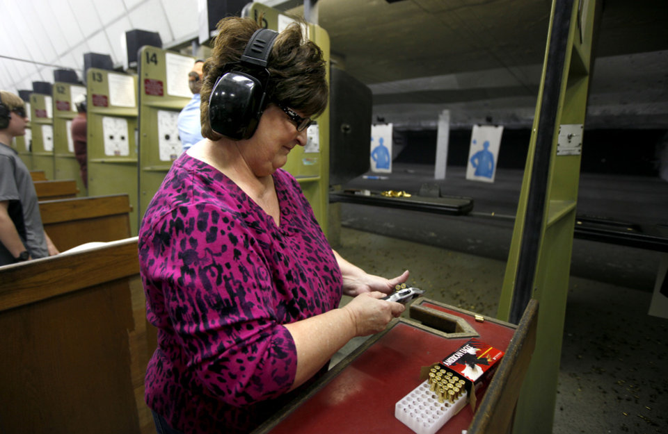 Peggy Osterholt of Okarche, Okla, gets ready to fire her handgun inside H&H Shooting Sports Complex in Oklahoma City, Tuesday, March 20, 2012. Photo by Bryan Terry, The Oklahoman