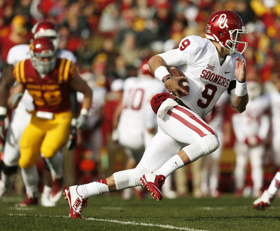 Photo - Oklahoma's Trevor Knight (9) carries the ball during a college football game between the University of Oklahoma Sooners (OU) and the Iowa State Cyclones (ISU) at Jack Trice Stadium in Ames, Iowa, Saturday, Nov. 1, 2014. Photo by Nate Billings, The Oklahoman