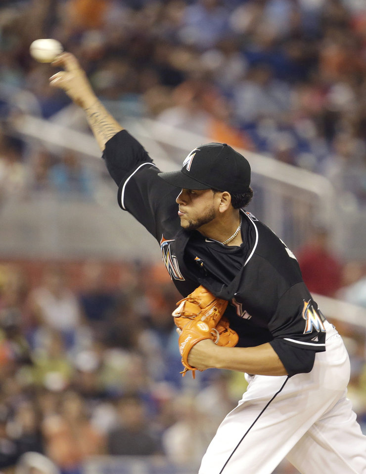 Photo - Miami Marlins starting pitcher Henderson Alvarez throws in the first inning during a baseball game against the Washington Nationals, Tuesday, July 29, 2014, in Miami. (AP Photo/Lynne Sladky)