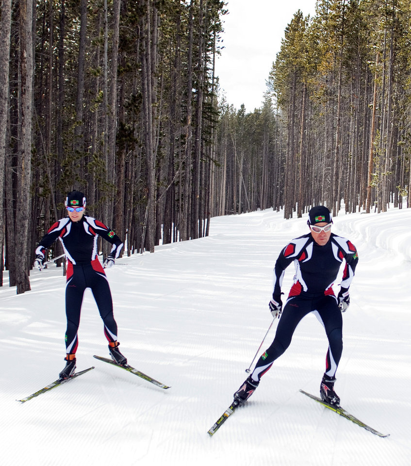 Photo - In this photo taken on Monday, Jan. 27, 2014, cross-country skiers Gary, right, and Angelica di Silvestri ski at the Yellowstone Club in Big Sky, Mont. The American-born man and his Italian-born wife will be representing the tiny Caribbean island nation of Dominica at the Winter Olympics in Sochi next month. The former finance professionals, granted Dominica citizenship for their philanthropic work on the island, are finishing their training in Montana while hastily arranging their own visas, travel logistics and footing the bill for the entire expedition. (AP Photo/Janie Osborne)