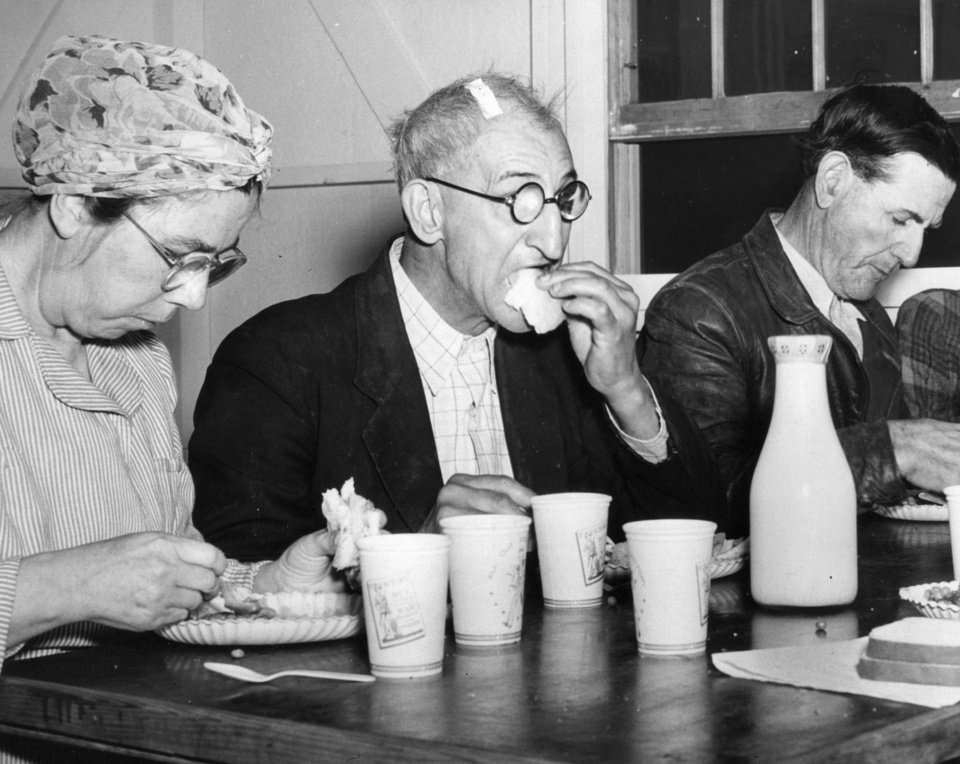 Photo - Survivors of the Woodward tornado, including this elderly man who suffered a cut on his head during the storm, enjoy a meal brought in and prepared by volunteers at a shelter.  The Woodward County town of 5,500 was devasted by the April 9, 1947, tornado, which was on the ground more than six  hours, traveling more than 200 miles from the  Texas Panhandle into Kansas.    4/22/1947