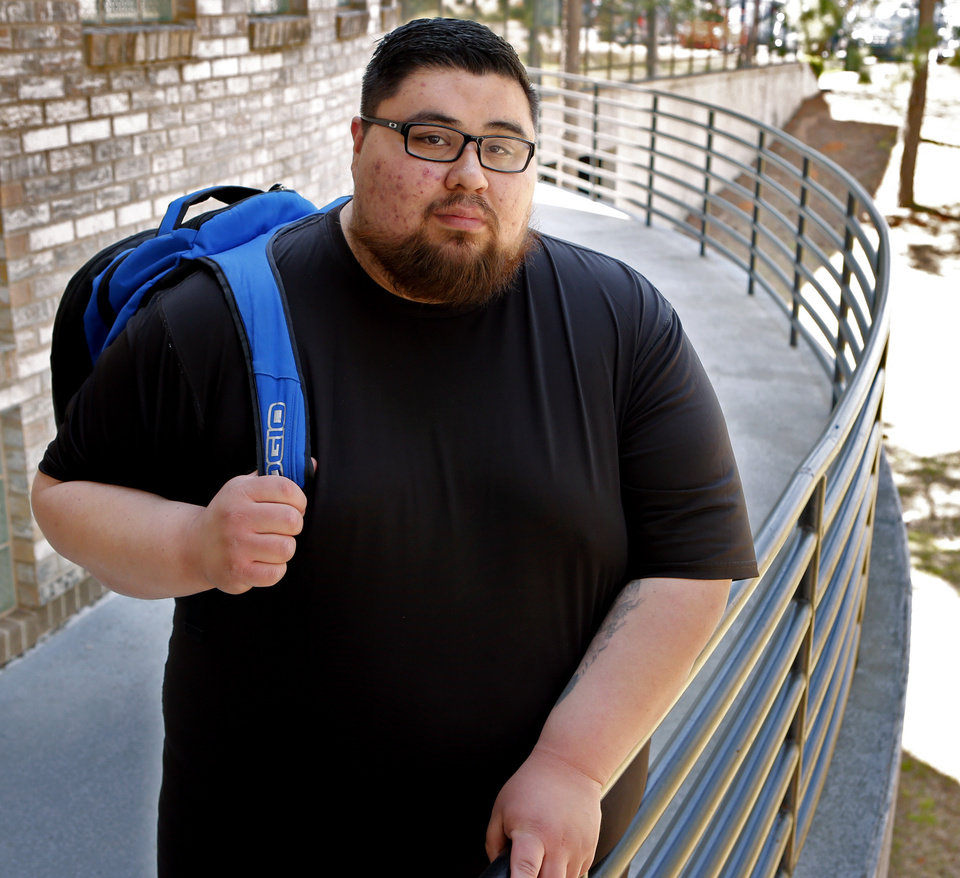 Photo -  Joshua Holley, whose brother, Jeffrey, died by suicide in 2015, attends Oklahoma State University-Oklahoma City.  [Photo by Steve Sisney, The Oklahoman]