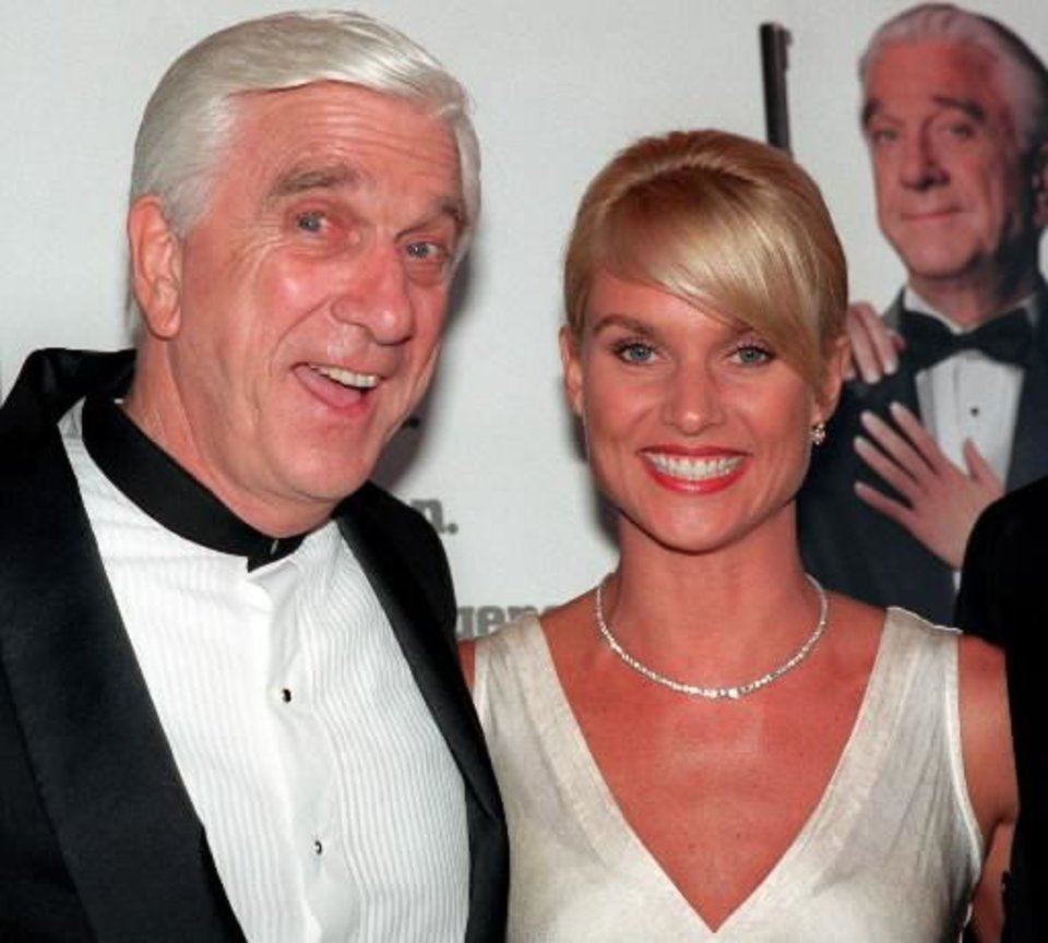 "Leslie Nielsen with Nicollette Sheridan, promoting ""Spy Hard"" in 1996."