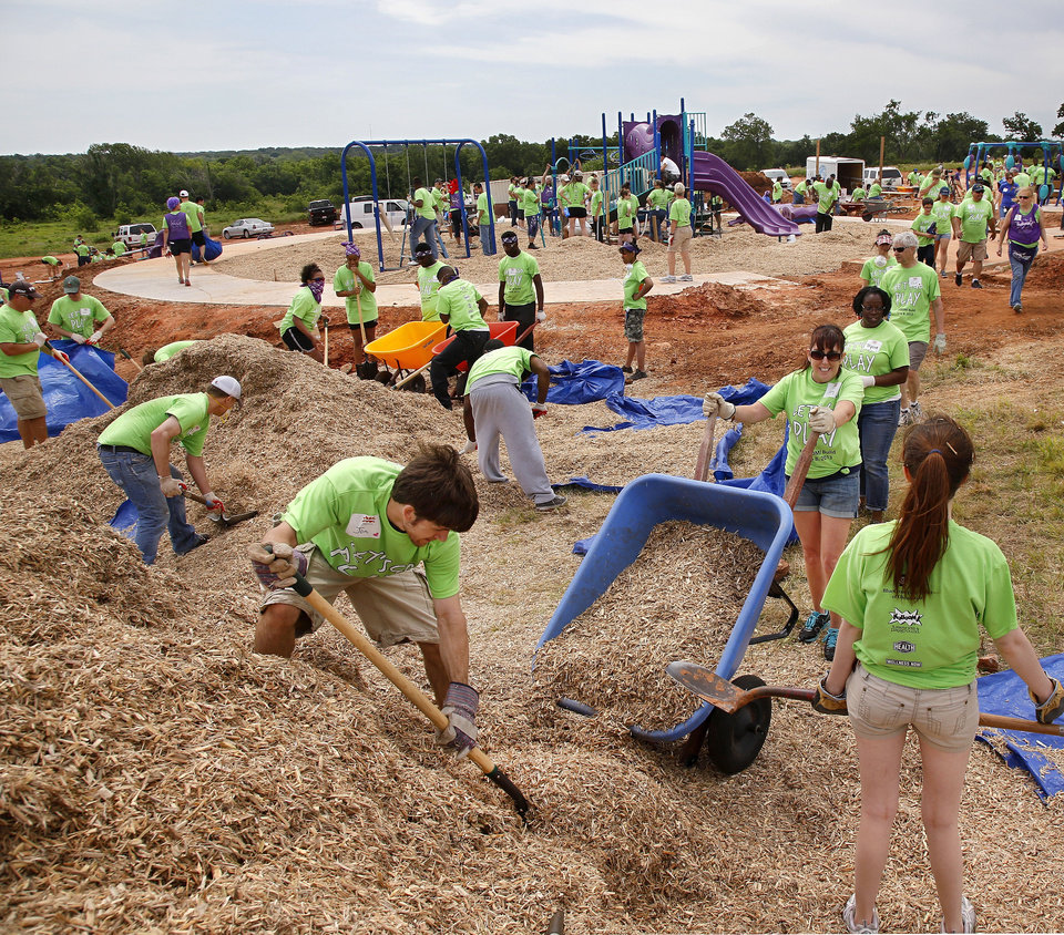 Photo - Organizers said about 140 volunteers from Partners in Public Health, Blue Cross and Blue Shield of Oklahoma, organizers from KaBOOM! and residents of the Oklahoma City community will provided the labor on Saturday, June 8, 2013, to build a new playground at the Northeast Regional Health and Wellness Center on NE 63 Street, east of MLK Blvd.  The new playground's design is based on drawings created by children who participated in a Design Day event in April.   Photo  by Jim Beckel, The Oklahoman.
