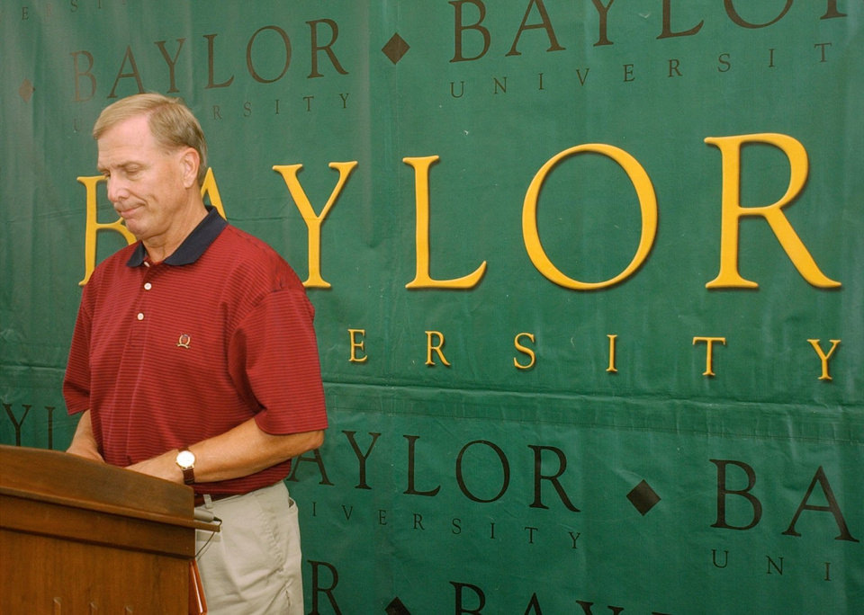 Photo - RESIGN: Baylor college basketball coach Dave Bliss looks down after announcing  his resignation Friday Aug, 8, 2003, in Waco, Texas. Bliss resigned  because of violations in his program that became known after the disappearance and death of a player allegedly killed by a former teammate. (AP Photo/Waco Tribune Herald, Rod Aydelotte)