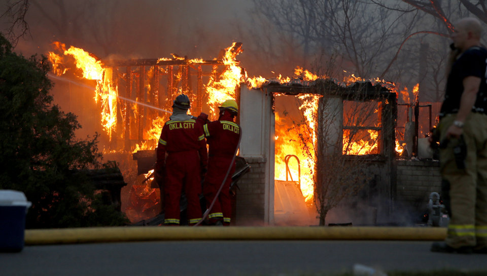 Oklahoma CIty firefighters try to control a house fire in Luther, Okla., after wildfire moved through the area on Friday, August 3, 2012. Photo by Bryan Terry, The Oklahoman