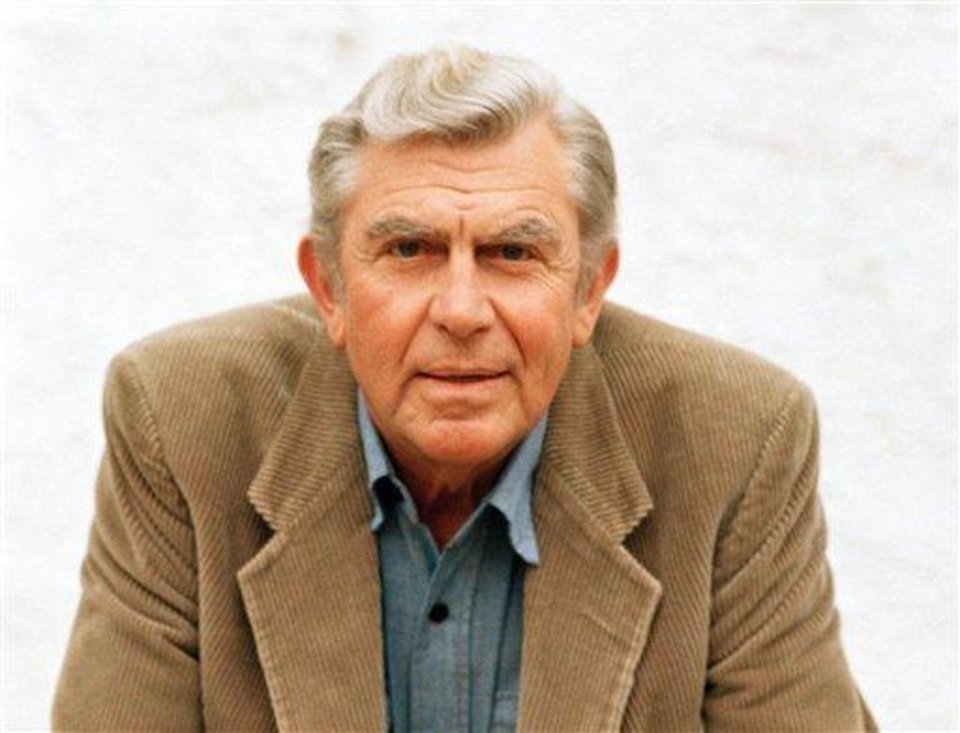 Photo - FILE - This March 6, 1987 file photo shows actor Andy Griffith in Toluca Lake, Calif. Griffith, whose homespun mix of humor and wisdom made