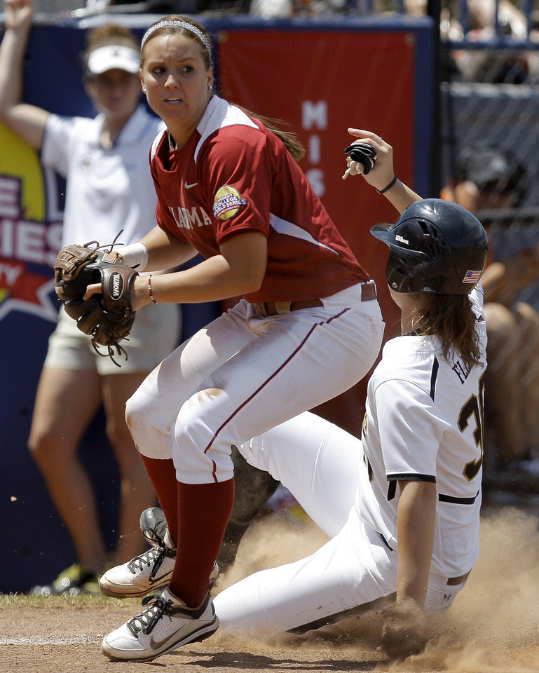 Photo - Oklahoma's Javen Henson (7) forces out Missouri's Ashley Fleming (30) at third base in the fourth inning of a Women's College World Series softball game between the University Oklahoma and Missouri at ASA Hall of Fame Stadium in Oklahoma City, Saturday, June 4, 2011.  Missouri won, 4-1. Photo by Bryan Terry, The Oklahoman