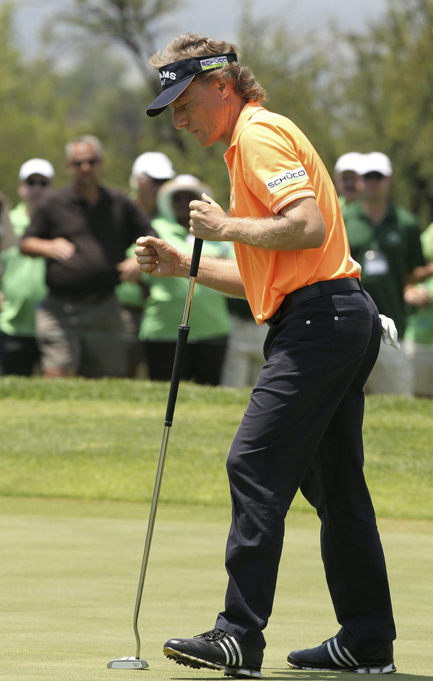 German golfer Bernhard Langer reacts after after playing a birdie shot on the 1st hole during the second day of the Nedbank Golf Challenge at the Gary Player Country Club in Sun City, South Africa on Friday Nov. 30, 2012. (AP Photo/Themba Hadebe)