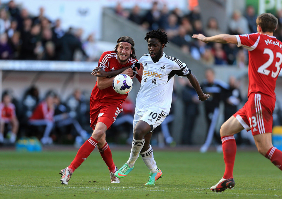 Photo - West Bromwich Albion's Jonas Olsson, left, and Swansea City's Wilfried Bony battle for the ball during their English Premier League soccer match at the Liberty Stadium, Swansea, Wales, Saturday, March 15, 2014. (AP Photo/Nick Potts, PA Wire)    UNITED KINGDOM OUT   -   NO SALES   -   NO ARCHIVES