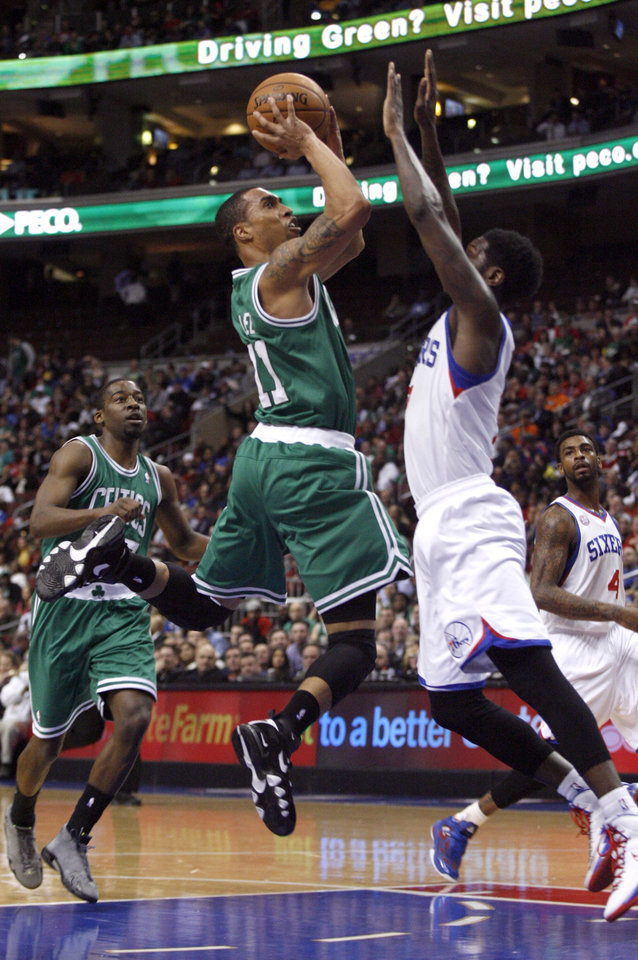 Boston Celtics' Courtney Lee (11) shoots as Philadelphia 76ers' Royal Ivey  defends in the first half of an NBA basketball game, Tuesday, March 5, 2013, in Philadelphia. (AP Photo/H. Rumph Jr)