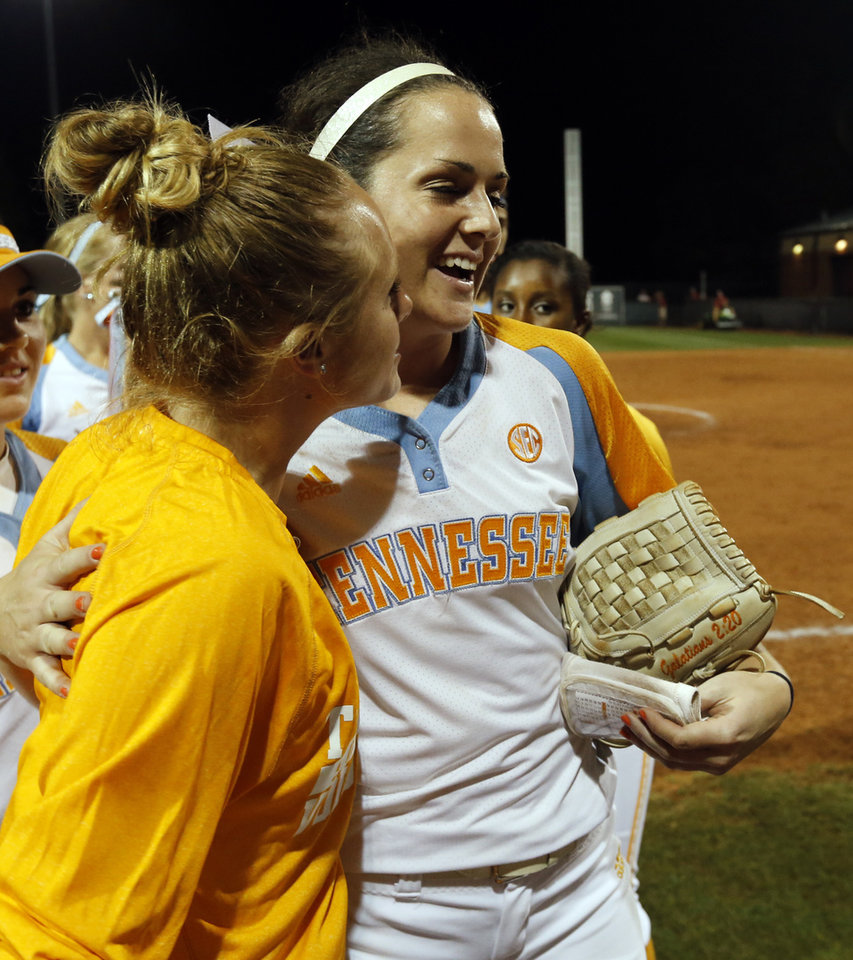 Photo - Tennessee pitcher Ellen Renfroe gets congratulations after a shut out as the University of Oklahoma Sooner (OU) softball team loses to Tennessee in game two of the NCAA super regional at Marita Hynes Field on May 24, 2014 in Norman, Okla. Photo by Steve Sisney, The Oklahoman