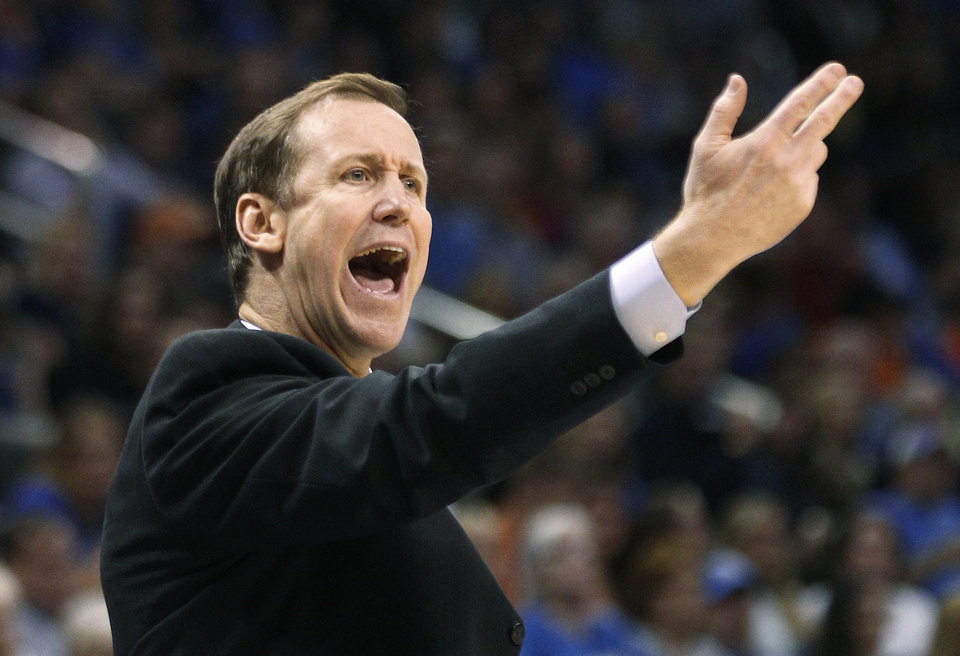 Photo -   Portland Trail Blazers coach Terry Stotts shouts to his team during the first quarter of an NBA basketball game against the Oklahoma City Thunder in Oklahoma City, Friday, Nov. 2, 2012. (AP Photo/Sue Ogrocki)