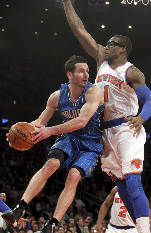 Orlando Magic's J.J. Redick, let,  goes up against New York Knicks' Amar'e Stoudemire during the second half of an NBA basketball game, Wednesday, Jan. 30, 2013, at Madison Square Garden in New York.  The Knicks won 113-97.(AP Photo/Mary Altaffer)