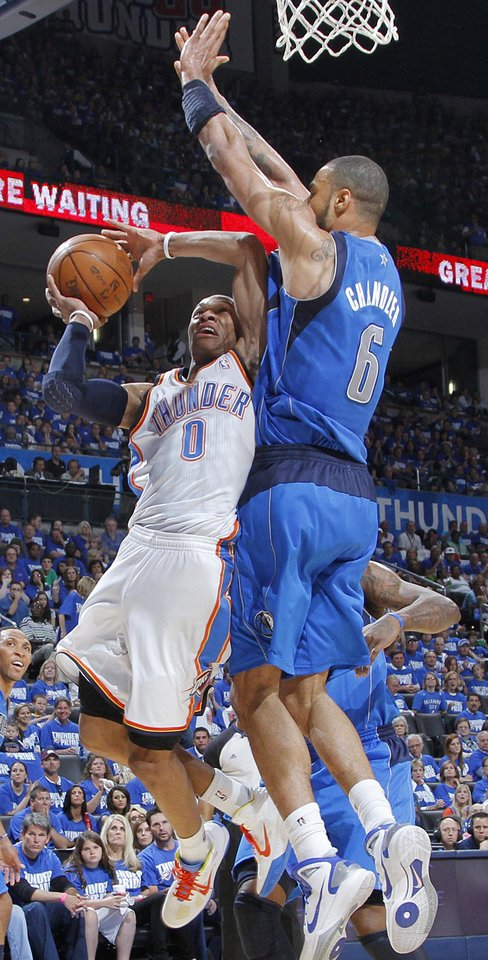 Oklahoma City's Russell Westbrook (0) is stopped by Tyson Chandler (6) of Dallas during game 3 of the Western Conference Finals of the NBA basketball playoffs between the Dallas Mavericks and the Oklahoma City Thunder at the OKC Arena in downtown Oklahoma City, Saturday, May 21, 2011. Photo by Chris Landsberger, The Oklahoman