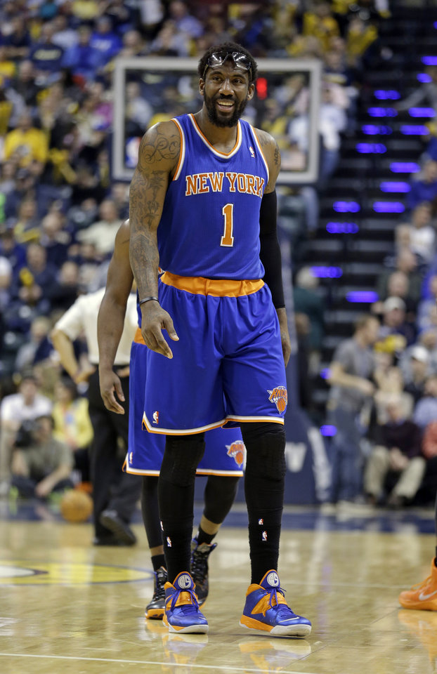 Photo - New York Knicks forward Amare Stoudemire walks off the court after being shaken up on a foul by the Indiana Pacers during the second half of an NBA basketball game in Indianapolis, Thursday, Jan. 16, 2014. The Pacers defeated the Knicks 117-89. (AP Photo/Michael Conroy)