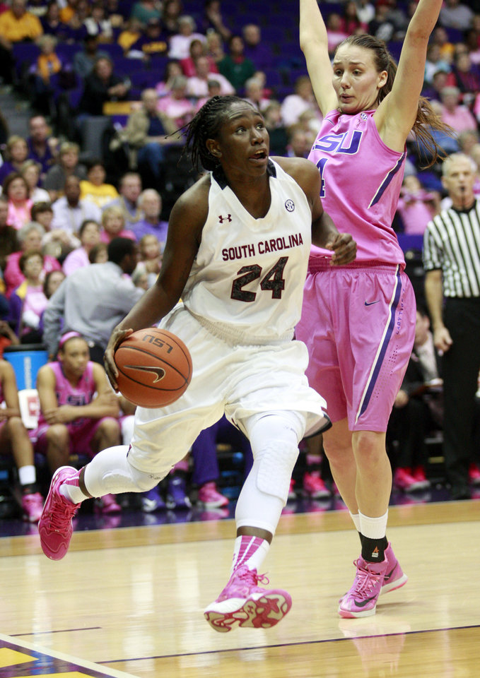 Photo - South Carolina forward Aleighsa Welch (24) drives past LSU guard Anne Pedersen in the first half of an NCAA college basketball game in Baton Rouge, La., Sunday, Feb. 16, 2014. (AP Photo/Tim Mueller)