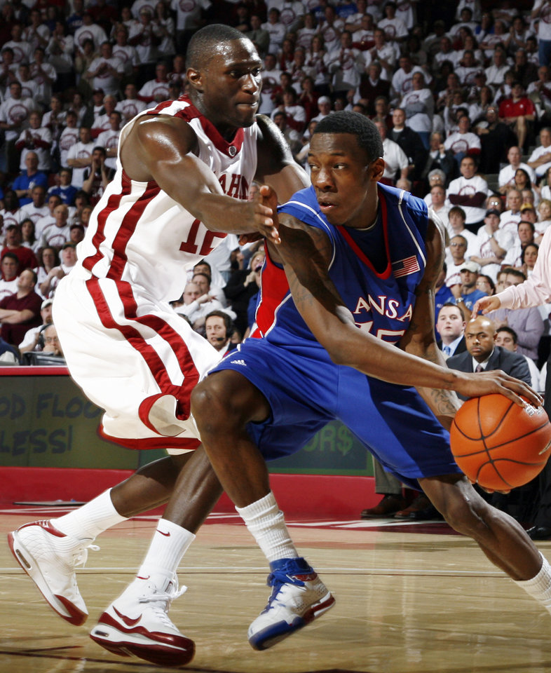 Photo - OU's Juan Pattillo (12) tries to stop KU's Tyshawn Taylor (15) in the second half of the men's college basketball game between Kansas and Oklahoma at the Lloyd Noble Center in Norman, Okla., Monday, February 23, 2009. KU won, 87-78. BY NATE BILLINGS, THE OKLAHOMAN