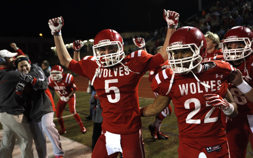 Photo - Davis' Kaleb Casey and Ty Milligan celebrate their win over Millwood in the Class 2A state football championship game  at Moore High School in Moore, Okla.,  Thursday, Dec. 19, 2013. Photo by Sarah Phipps, The Oklahoman