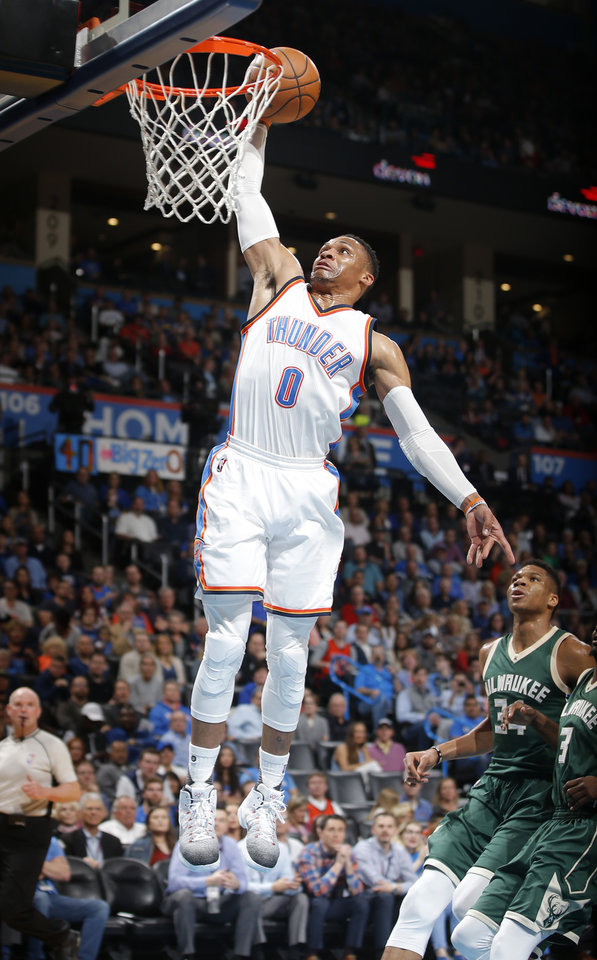 Photo -  Russell Westbrook goes up for a dunk in front of Milwaukee's Giannis Antetokounmpo during Tuesday's game between the Oklahoma City Thunder and the Milwaukee Bucks at Chesapeake Energy Arena. The Thunder won, 110-79. [Photo by Bryan Terry, The Oklahoman]