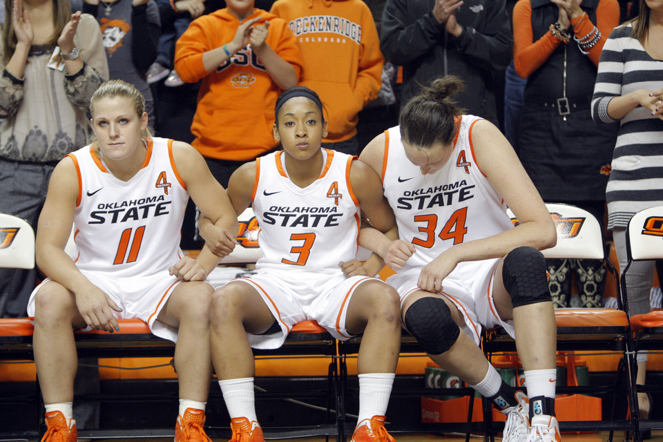 Photo - Oklahoma State's Jenni Bryan (11), Tiffany Bias (3) and Vicky McIntyre (34) wait to be introduced before the women's college game between Oklahoma State University and Coppin State at Gallagher-Iba Arena in Stillwater, Okla.,  Saturday, Nov. 26, 2011.  Photo by Sarah Phipps, The Oklahoman
