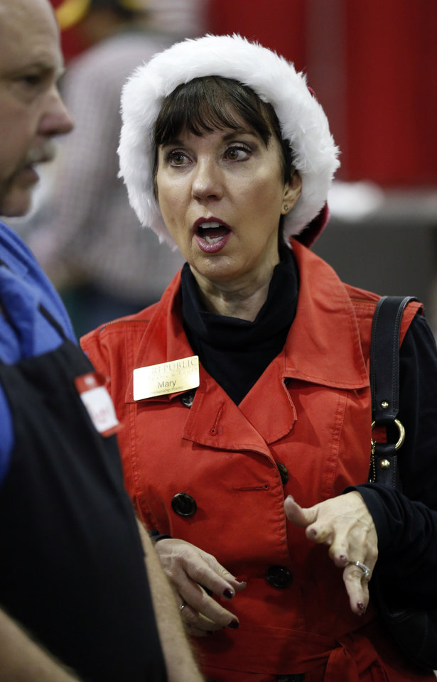 Photo -  Red Andrews Christmas Dinner board member Mary Blankenship Pointer talks with volunteers at Cox Convention Center. [Photo by Steve Sisney, The Oklahoman]