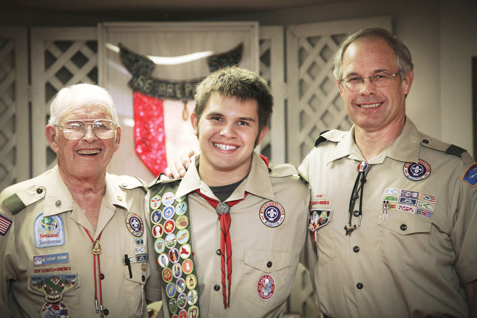 Photo - Dee Browning, right, stands with his dad, Courtney Browning, and grandson Caleb Browning at Caleb's Eagle Scout ceremony. Photo Provided
