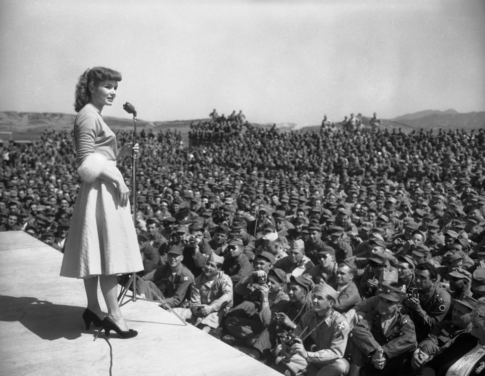 "Photo - FILE- In this May 22, 1955, file photo, actress Debbie Reynolds entertains at 8th Army headquarters in Seoul, South Korea. Reynolds, star of the 1952 classic ""Singin' in the Rain"" and mother of Carrie Fisher, died Wednesday, Dec. 28, 2016, according to her son Todd Fisher. She was 84. (AP Photo, File)"