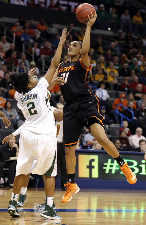Photo - Oklahoma State's Kendra Suttles (31) shoots over Baylor's Niya Johnson (2) during the Women's Big 12 basketball tournament game between Baylor and Oklahoma State at Chesapeake Energy Arena  in Oklahoma City, Okla., Sunday, March 9, 2014. Photo by Sarah Phipps, The Oklahoman
