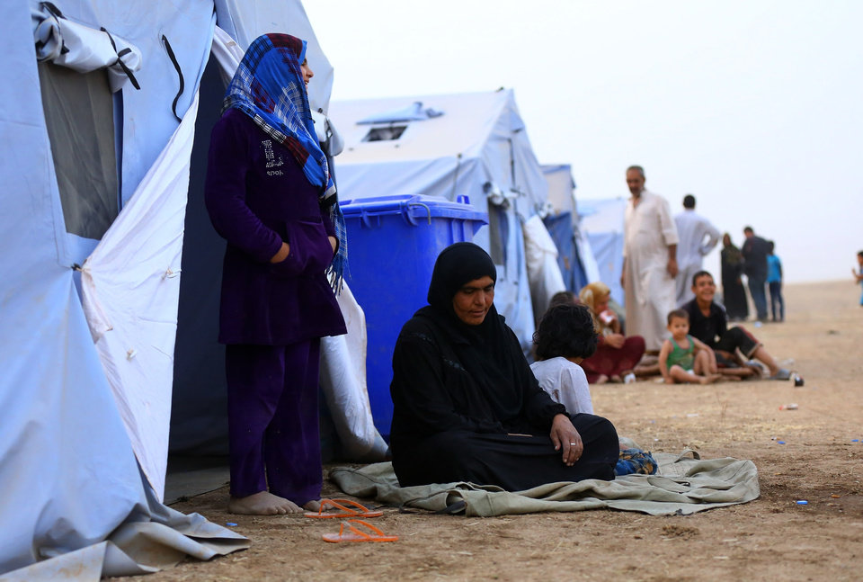 Photo - Iraqi refugees from Mosul at Khazir refugee camp outside Irbil, 217 miles (350 kilometers) north of Baghdad, Iraq, Thursday, June 12, 2014. The Islamic State of Iraq and the Levant, the al-Qaida breakaway group, on Monday and Tuesday took over much of Mosul in Iraq and then swept into the city of Tikrit further south. An estimated half a million residents fled Mosul, the economically important city. (AP Photo)