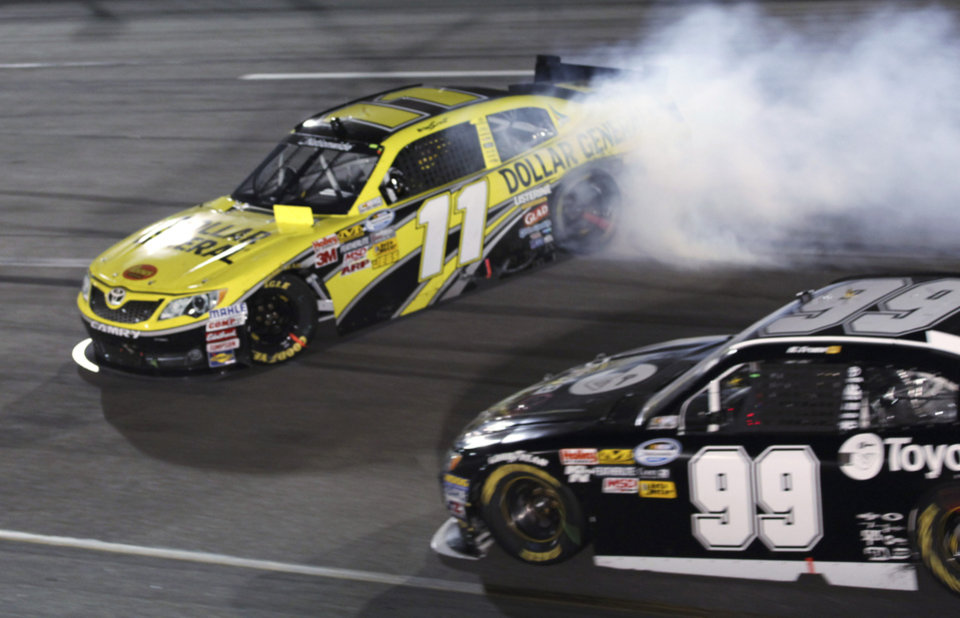 Photo -   Brian Scott (11) spins out in front of Ryan Truex (99) during the NASCAR Nationwide Series auto race at Richmond International Raceway in Richmond, Va., Friday, Sept. 7, 2012. (AP Photo/Zach Gibson)