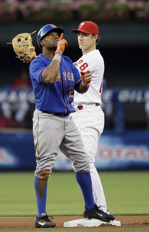 New York Mets' Eric Young Jr., left, reacts after hitting a double as Philadelphia Phillies second baseman Chase Utley looks on during the fourth inning of a baseball game on Friday, June 21, 2013, in Philadelphia. (AP Photo/Matt Slocum)
