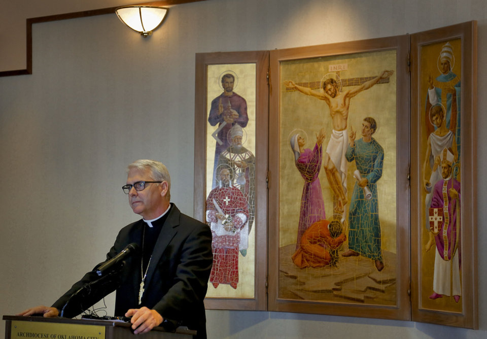 Photo - Archbishop Paul S. Coakley talks about the resignation of Pope Benedict XVI during a news conference on Monday at the Catholic Pastoral Center, 7501 Northwest Expressway in Oklahoma City. Photo by Chris Landsberger, The Oklahoman  CHRIS LANDSBERGER - CHRIS LANDSBERGER