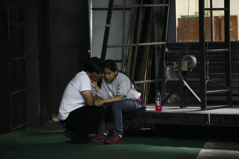 Photo -   In this Sept. 21, 2012 photo, singer Jennyfer Avila, experiencing a bout of stage fright, is comforted by her father prior to her performance in