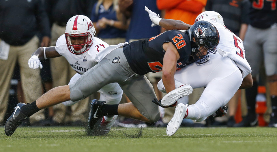 Photo - Oklahoma State's Malcolm Rodriguez (20) stops South Alabama's Tra Minter (5) on fourth down in the first quarter during a college football game between Oklahoma State (OSU) and South Alabama at Boone Pickens Stadium in Stillwater, Okla., Saturday, Sept. 8, 2018. Photo by Nate Billings, The Oklahoman